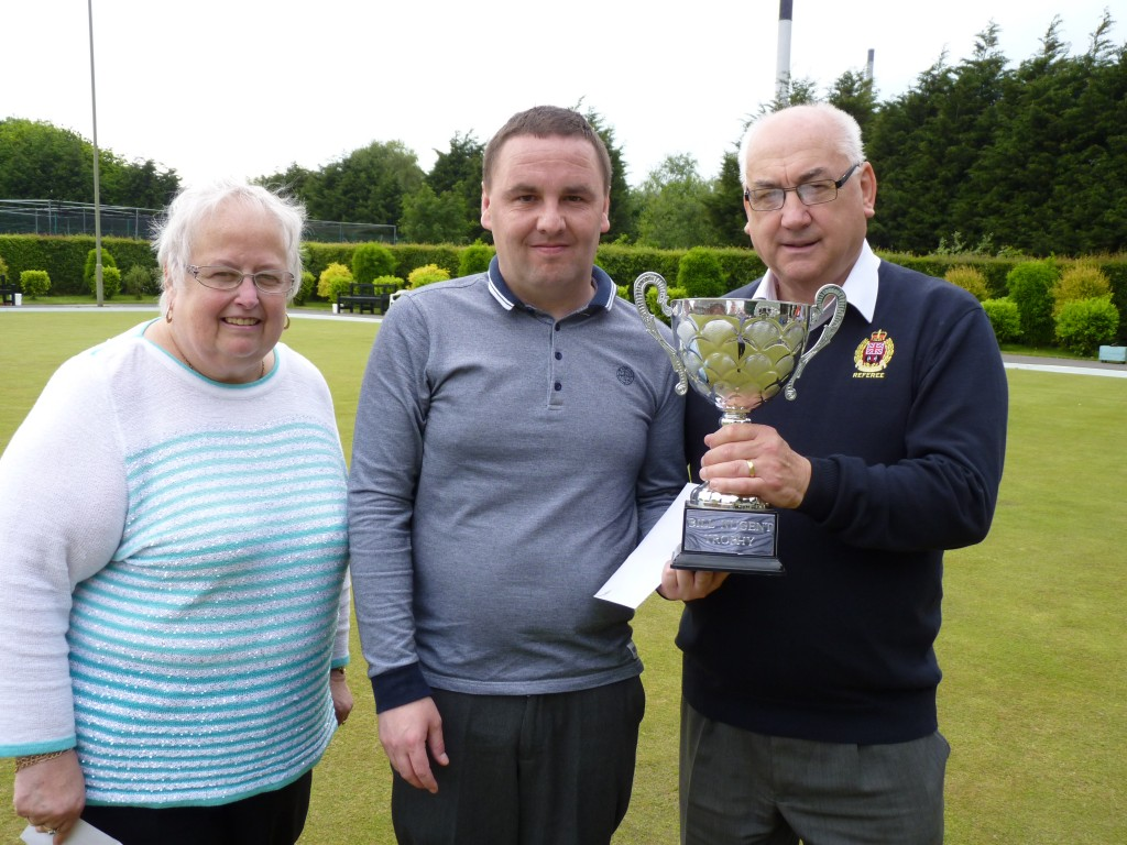 Nick Burridge receives the Merseyside Merit Trophy from John Crowther who sponsored the competition. Deputy President, Pat Crowther, also made the presentations.