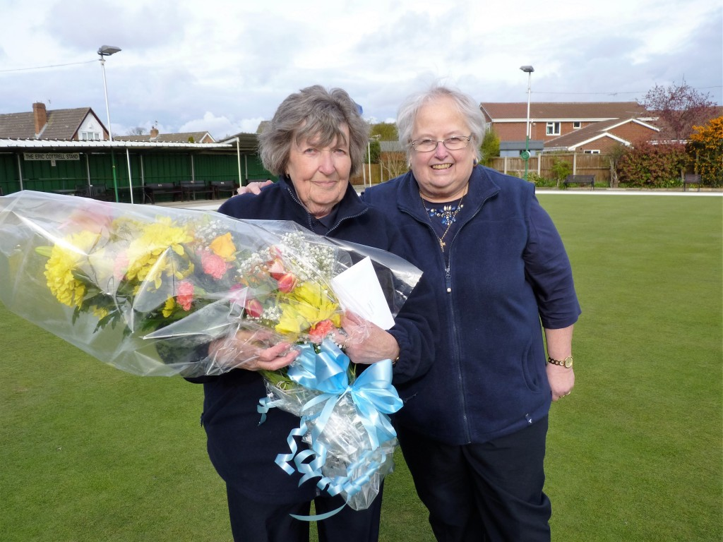 Naureen Bunting receives a boquet of flowers from Deputy President, Pat Crowther on the occassion of her 100th cap.