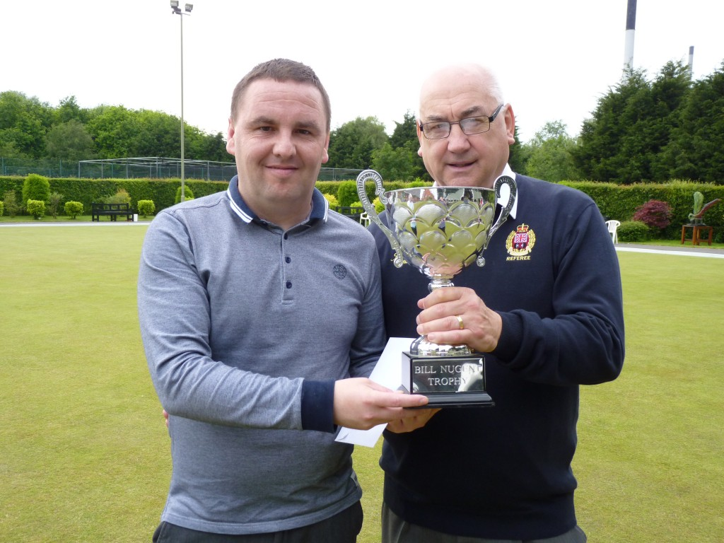 Nick Burridge Jnr receives the Merseyside Merit trophy from sponsor, John Crowther