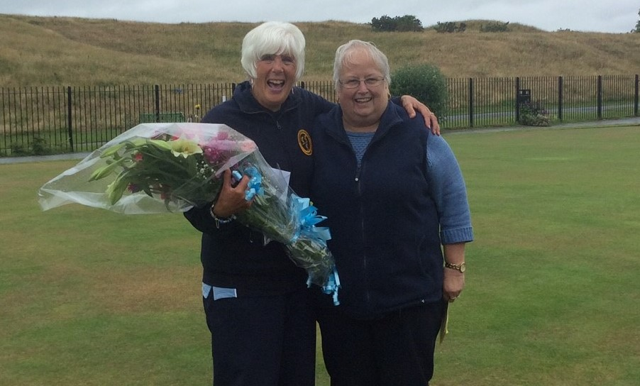 Sandra Astles receives a boquet of flowers from Deputy President, Pat Crowther on the occassion of her 100th cap.